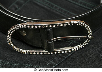 belt buckle studded with zircon - Closeup of silver belt...