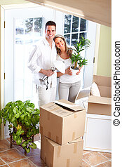 Moving - Young happy couple  moving into their new home
