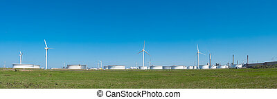 oil tanks - windmills between large white tanks for petrol...