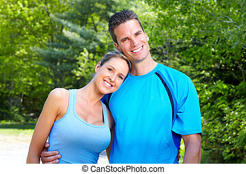 Young couple. - Young loving couple relaxing in park. Healty...