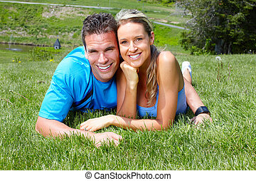 Young couple - Young loving couple relaxing in park Healty...