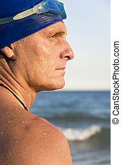 Male swimmer in profile - A Male swimmer standing in profile...