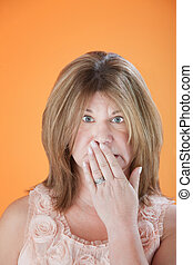 Worried Woman - Worried mature Caucasian woman with hand on...