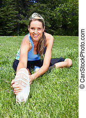 Fitness woman. - Young woman doing exercise in park. Healty...