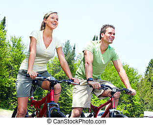 Riding couple. - Happy smiling couple  riding  in the park