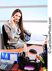 diary - Beautiful business woman is working at the office