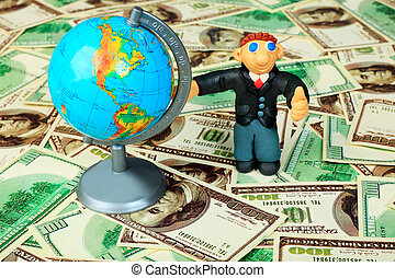 globalization - Shot of a plasticine businessman in a suit....
