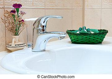 Hotel bathroom: sink, tap and bathroom set