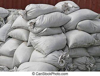 Getting ready for the flood - Large pile of white sandbags