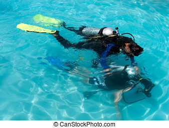 Learning to scuba dive. - A boy learning to scuba dive...