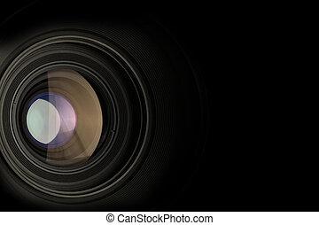 camera lens - closeup of a camera lens on black background