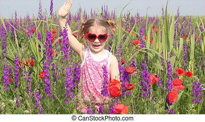 little girl standing in colorful me