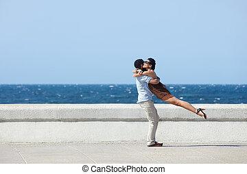happy hug between beautiful wife and husband - euphoric...