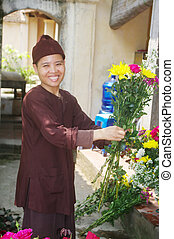 Buddhist nun - A large shipment of flowers to the pagoda...