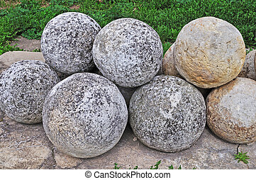 Pile of stone cannon balls - Collection of old stone cannon...