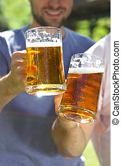 Men with glasses of the light beer