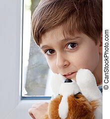 Portrait of a boy with a toy in the hands of