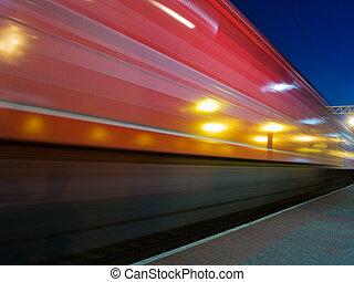 red speeding night train blur