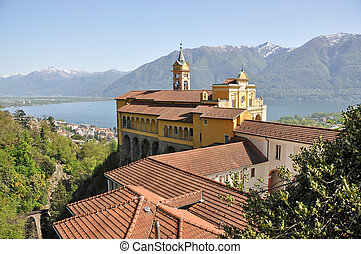 Madonna del Sasso, medieval monastery on the rock overlook...