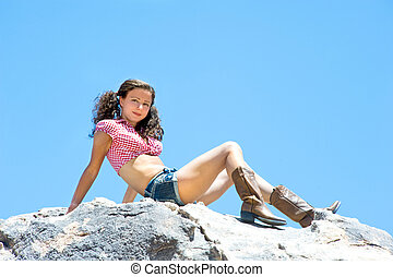 Sexy woman on mountaintop - A sexy woman with short shorts...