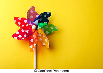 Windmill toy isolated on yellow background - Childrens...