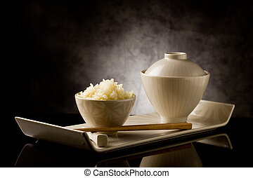 Rice with chopsticks - delicious asian rice plate with...
