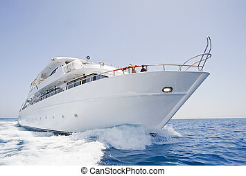 Large motor yacht under way at sea - A large private motor...
