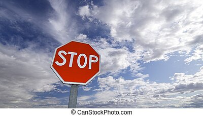 stop - view of a stop signal with cloudy sky