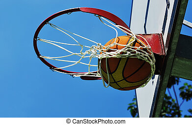 Basketball swish - ball in the ring - bautiful day for play