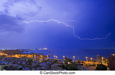 Lightning over a coastal town