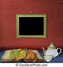 The wooden frame on the wall and teapot with cup of tea on...