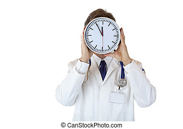 Stressed doctor with clock in front of face as sign of time...