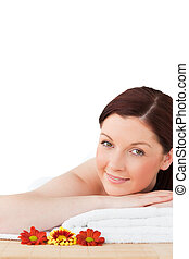 Portrait of a young red-haired woman posing while relaxing in a spa centre