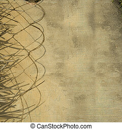 Leaf and rope divider on grunge wall background