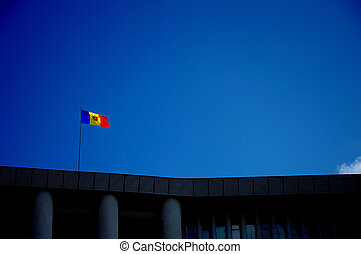 Flag on the top of the parliament building in Moldova - This...