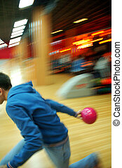 Man bowling, lateral view - This photograph represent a man...