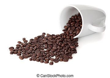 Spilled cup of coffee beans against a white background