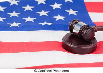 US flag and brown gavel