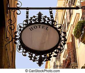 Vintage hotel. - Antique wrought iron hotel sign in a...
