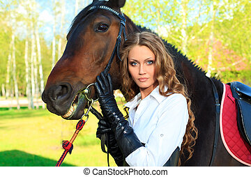 equine - Beautiful young woman with a horse outdoor.