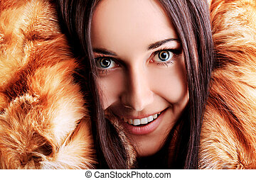 lady - Portrait of a beautiful young woman in a fur.