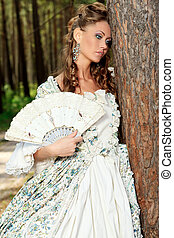 medieval - Beautiful young woman in medieval era dress on a...