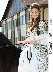 lady - Beautiful young woman in medieval dress with a horse...