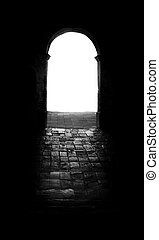 Entrance - An arched open door way leading into a white...