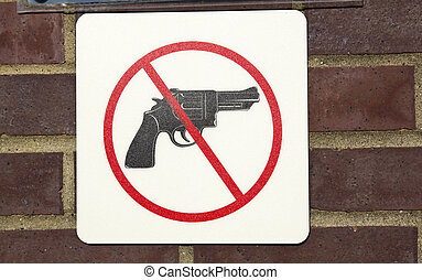 No guns permitted - sign saw on the wall
