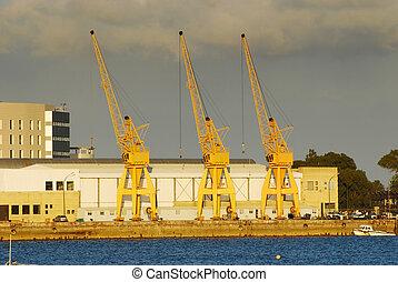 Cranes working in Port of Huelva - Yellow huge heavy...