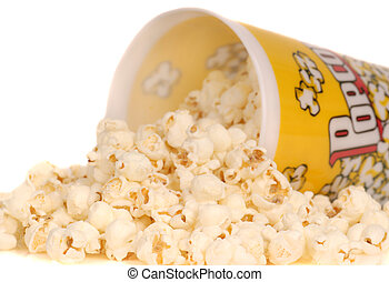 Container of popcorn with popcorn spilling out - Container...