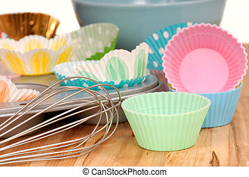 Variety of cupcake liners with wire wisk - Variety of...