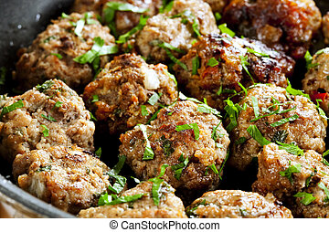 Meatballs Cooking - Meatballs cooking in a pan, with parsley...