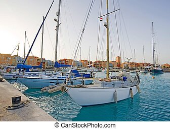 Sailing yachts in a marina
